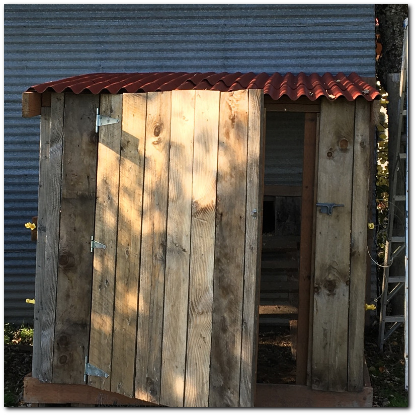 Finished chicken run with old barn wood