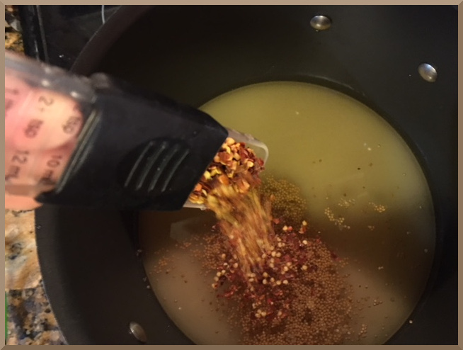 Add the crushed red pepper to the pickle brine